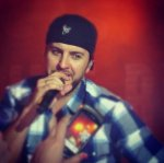 "Brittany H. - Niagara, WI - ""Luke Bryan at the Island Resort and Casino in Escanaba, Michigan. I jumped on my friend's shoulders and gave him our tickets to sign! This was my first time seeing him in concert. I have now seen him 3 times, soon to be 4!"""