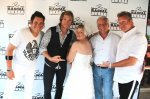 "Mark P. - Camden, NJ - ""Mark & Barbara renewed their wedding vows at the Flatts Fest ""Why Wait Wedding Chapel""! prior to the July 9th show in Camden N.J Then Rascal Flatts signed Barbara's wedding dress!"""